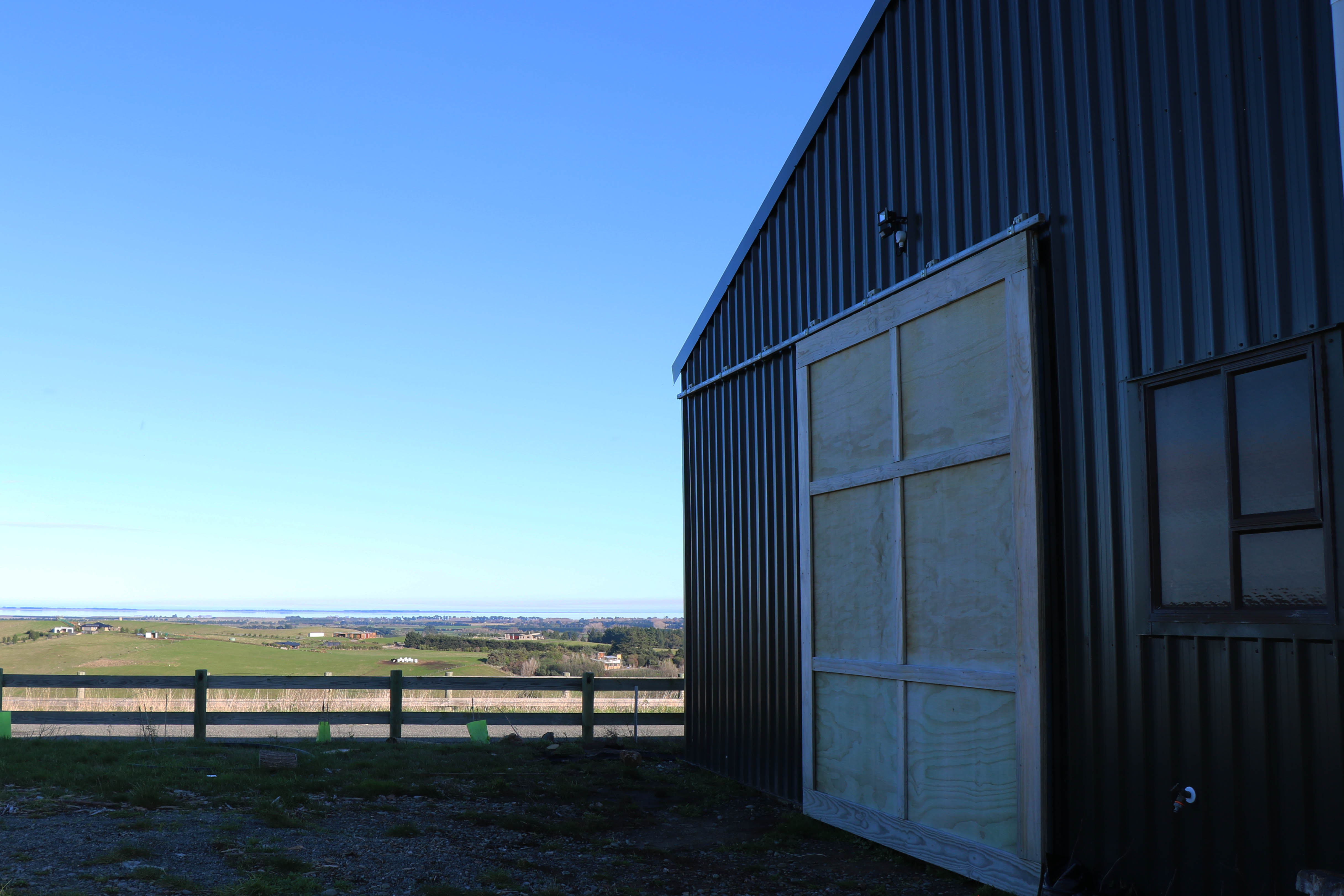 customised roller door on a clearspan shed