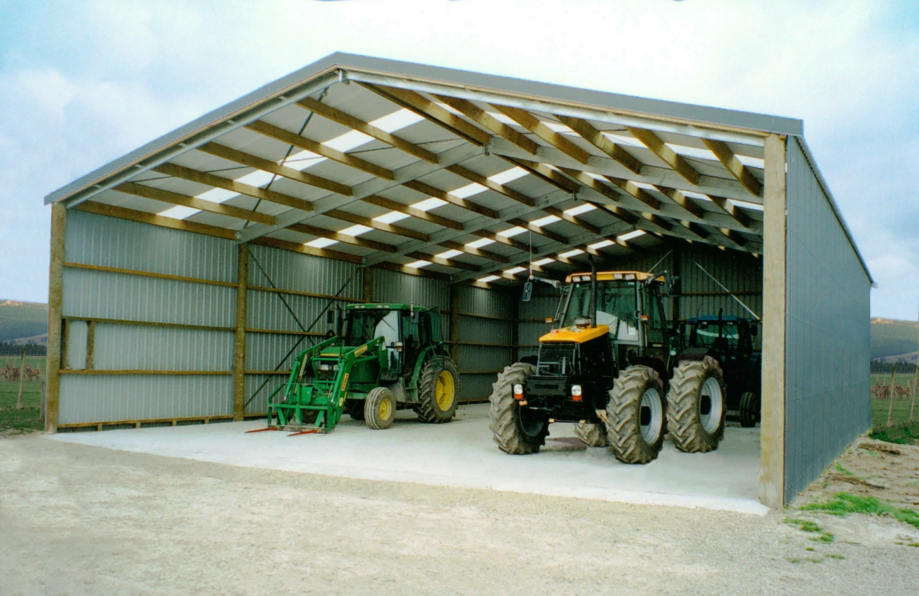 Open-sided large contractor shed with implements inside
