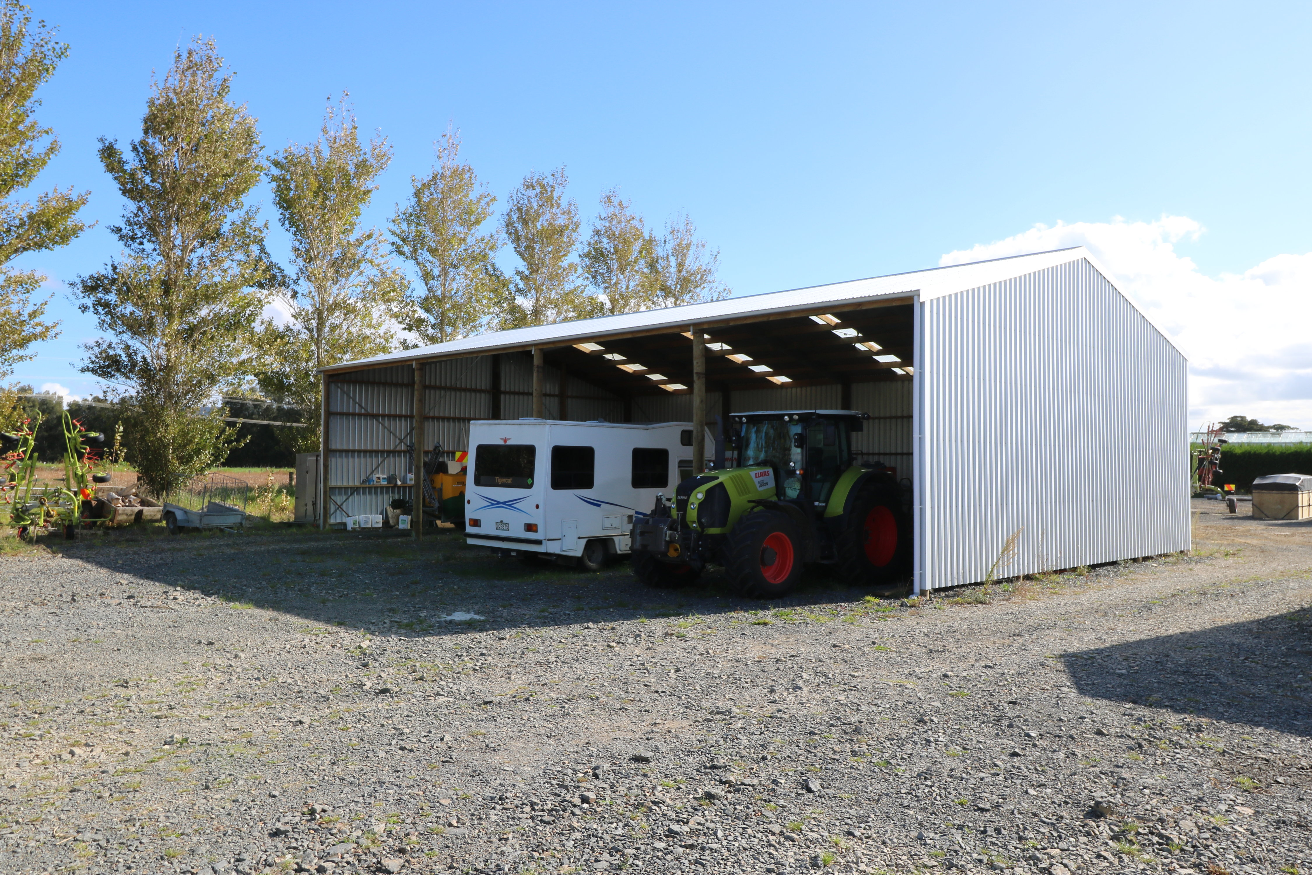 Storing implements and machinery is easy with a higher and wider Alpine shed